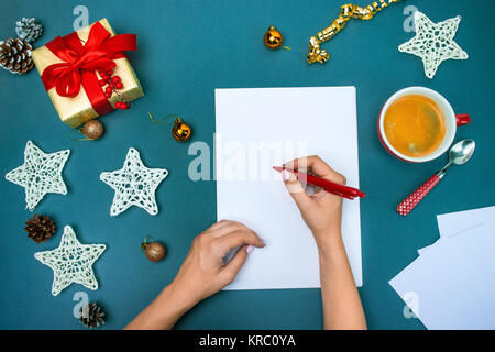 The famale hands with Christmas decorations. - Stock Photo
