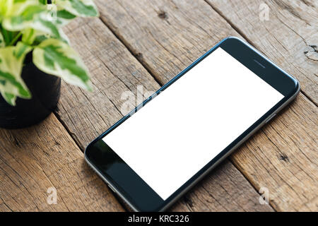 close up phone white screen on wood desk - Stock Photo