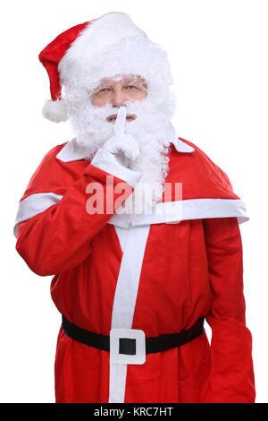 Weihnachtsmann Nikolaus Weihnachten Geheimnis freigestellt vor einem weissen Hintergrund - Stock Photo