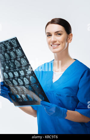 Professional  female doctor receiving scan - Stock Photo