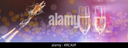 Two glasses of champagne against champagne cork popping - Stock Photo