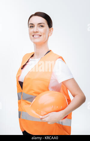 Adorable female worker posing in uniform - Stock Photo