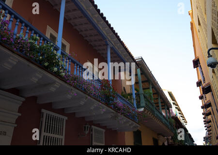 Beautiful flowers bloom on the verandas of traditional houses in a Cartagena old street - Stock Photo