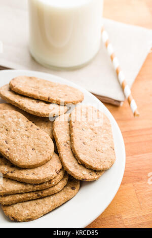 Tasty oatmeal cookies on wooden table. - Stock Photo