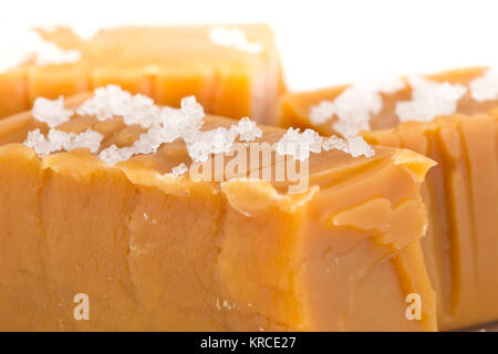 Hand made caramel toffee pieces with sea salt macro with selective focus - Stock Photo