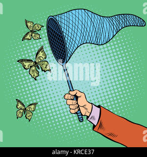 Businessman catching money with a butterfly net - Stock Photo