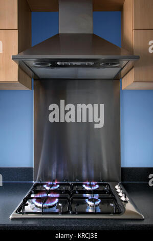 Modern steel kitchen gas hob and extractor hood. - Stock Photo