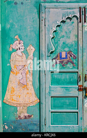 Detail from wall art near an entrance to the City Palace in Udaipur, India, which dates from the sixteenth century - Stock Photo