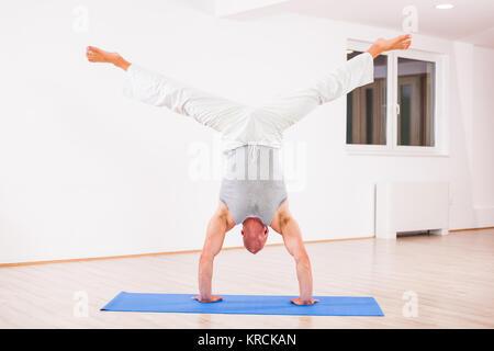 1 indian adult man yoga stretching stock photo 87866514