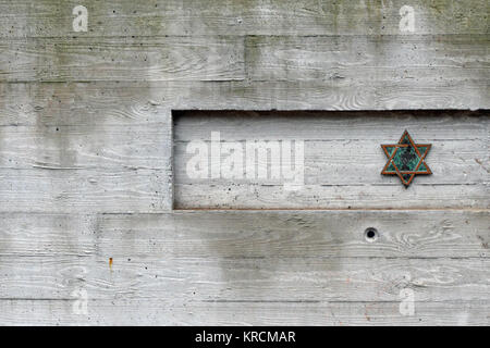 BERLIN, GERMANY - December 16 2017: Star of David on concrete wall in front of the Old Jewish cemetery in Grosse - Stock Photo