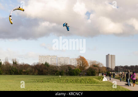 Southampton, England, UK - February 16, 2014: People participate in kite landboarding on a sunny day in a park at - Stock Photo