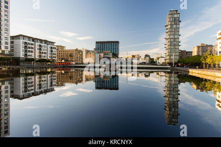 Dublin, Ireland - September 18, 2016: Apartment buildings, office blocks and warehouses are reflected in the Grand - Stock Photo
