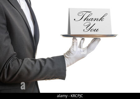 Thank you concept. Waiter offering a tray with a Thank you card, - Stock Photo