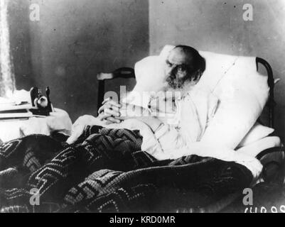The Russian writer, Leo Tolstoy, on his deathbed at Astapovo.       Date: 1828 - 1910 - Stock Photo
