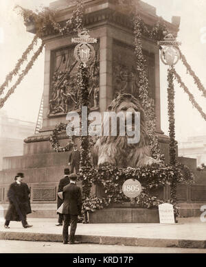 View of one of the lions at the foot of Nelson's Column in Trafalgar Square, Central London, at the time of the - Stock Photo