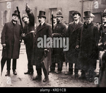 Winston Churchill, then Home Secretary, together with policemen and civilians, during the Sidney Street Siege (popularly - Stock Photo