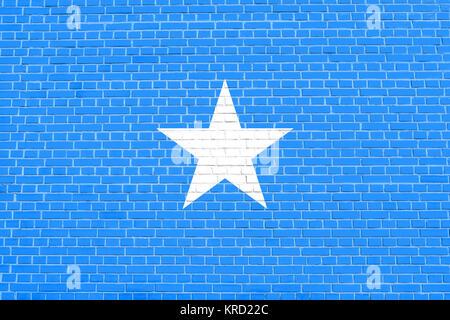 Flag of Somalia on brick wall texture background - Stock Photo