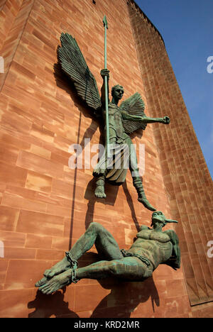 Bronze sculpture entitled St Michael's Victory over the Devil, on an outer wall of Coventry Cathedral.  It was sculpted - Stock Photo