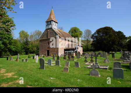 St Michael and All Angels Church, a Norman church in Castle Frome, Herefordshire, seen from across the churchyard. - Stock Photo
