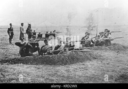 Russian Troops fire bayonettes from trenches during the Russo-Turkish war (April 24, 1877  March 3, 1878).     Date: - Stock Photo