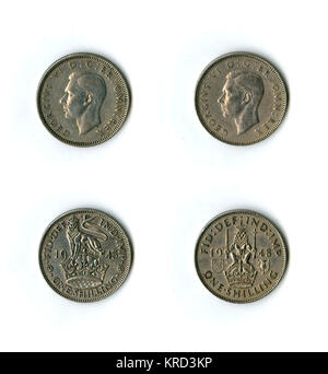 British coins, two George VI shillings for 1945 and 1948.  With a lion and crown on the reverse, showing two different - Stock Photo