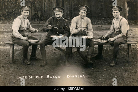 Four soldiers of the Royal Artillery enjoy some lunch during the First World War.     Date: c.1916 - Stock Photo