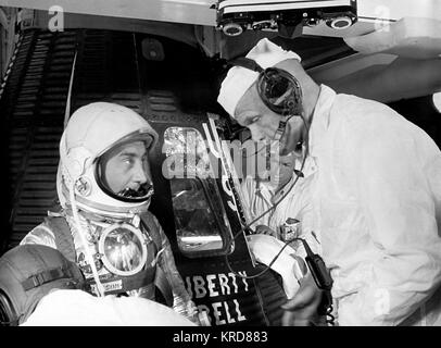 Astronaut Grissom, Virgil Chats with Astronaut Glenn, John prior to Entering Liberty Bell 7 Capsule for MR-4 Mission - Stock Photo