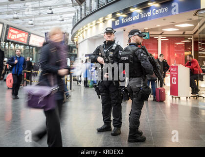 Armed British Transport Police officers on patrol in Manchester Piccadilly as the force announces that for the first - Stock Photo