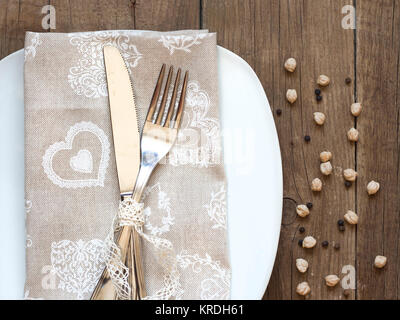 Rustic Table setting on old wooden table - Stock Photo