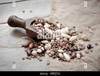Legumes mix in the wood spoon - Stock Photo