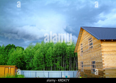wooden house for a rural plot in the spring, Russia - Stock Photo