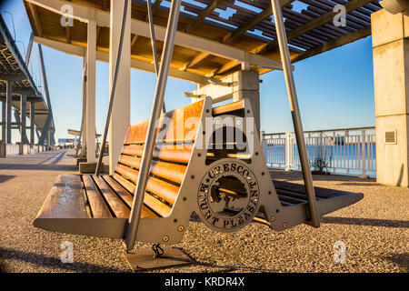 A bench on the pier in Mount Pleasant's park - Stock Photo