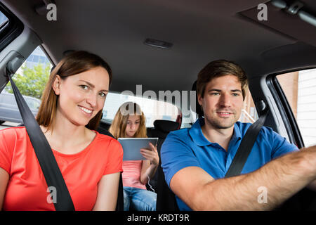 Family Going For A Ride In Car