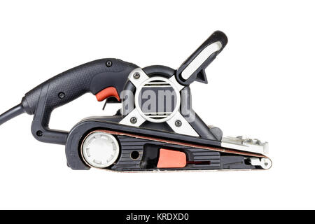 A side shot of a 3in belt sander on white background. - Stock Photo