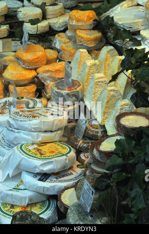 a selection of speciality French cheeses on sale on a delicatessen stall at borough market in southwark, London. - Stock Photo