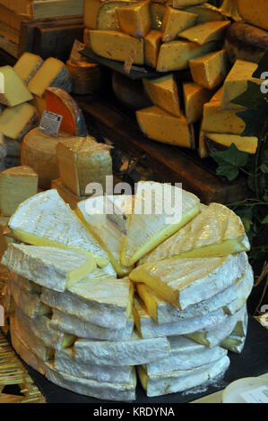 Speciality cheeses on sale at borough market in Southwark, london. French Brie and a selection of cheese at a delicatessen - Stock Photo