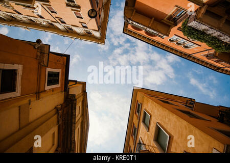 Building with traditional architecture on a narrow street in Verona, Italy. - Stock Photo