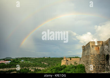 Double rainbow over San Pedro De La Roca castle walls, Santiago De Cuba, Cuba - Stock Photo
