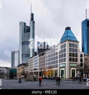 Frankfurt,Germany,Goetheplatz. Urban city cntre view of Commerz bank high-rise skyscraper, shops & monuments on - Stock Photo