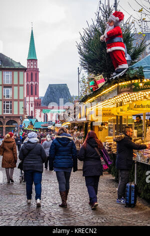Frankfurt,Germany. People enjoyTraditional German Market stalls in Römerberg square with half-timbered historic - Stock Photo