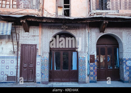 Old house with traditional Arabic ornaments in Medina, old city in Marrakech - Stock Photo