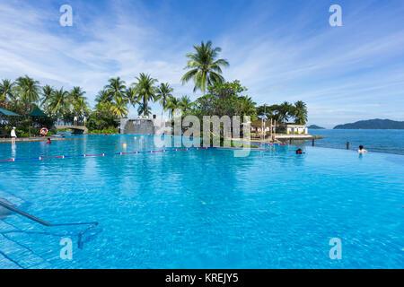 Kota Kinabalu, Malaysia - February 18, 2017: Beautiful infinity pool at Shangri-La Hotel and Resort in Sabah Borneo, - Stock Photo