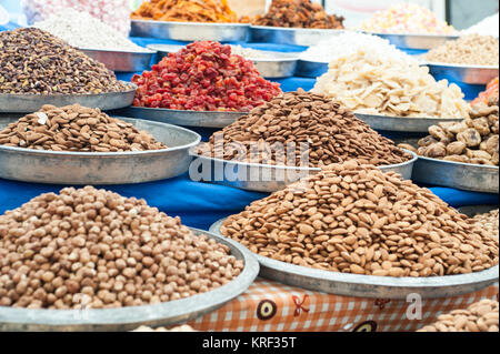the colors, the aromas and the atmosphere of the Turgutris market in Turkey - Stock Photo
