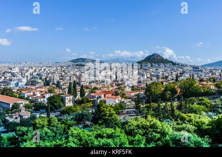 Panoramic view of the city of Athens from the hill of Philopappos in which Mount Lycabettus stands the tallest of - Stock Photo