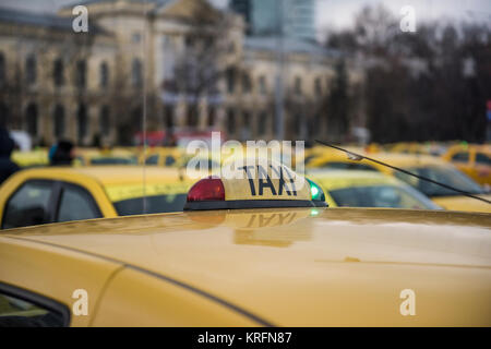 Bucharest, Romania  - December 20, 2017: Romanian taxi drivers protest in front of the government headquarters against Uber and other apps that steal their clients.