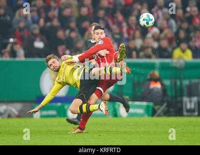 FC Bayern Munich Soccer, Munich, December 20, 2017 James RODRIGUEZ, FCB 11   compete for the ball against  Marcel - Stock Photo
