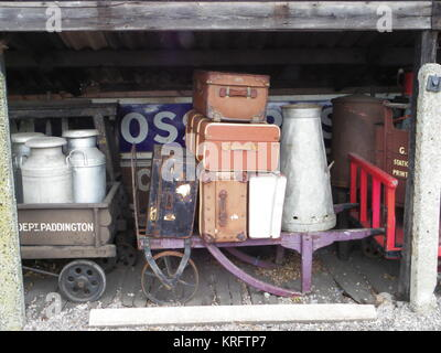 Old suitcases and milk churns on Victorian trolleys at the Didcot Railway Museum, Oxfordshire.      Date: circa - Stock Photo