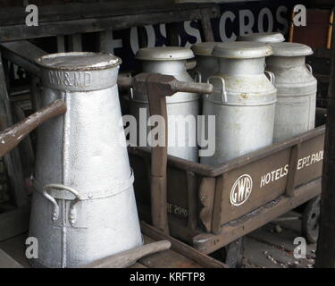 Old milk churns on Victorian trolleys at the Didcot Railway Museum, Oxfordshire.      Date: circa 2011 - Stock Photo