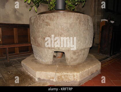 Ancient font in St Stephen's parish church (also known as Old Radnor parish church), Radnor, Powys, Wales.  The - Stock Photo