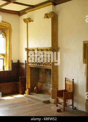 Carved fireplace in Muchelney Abbey, a Grade I listed building in the village of Muchelney, Somerset.      Date: - Stock Photo
